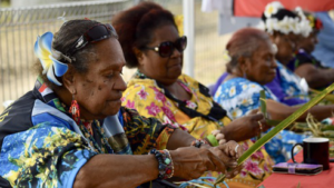 Picture of women doing cultural weaving